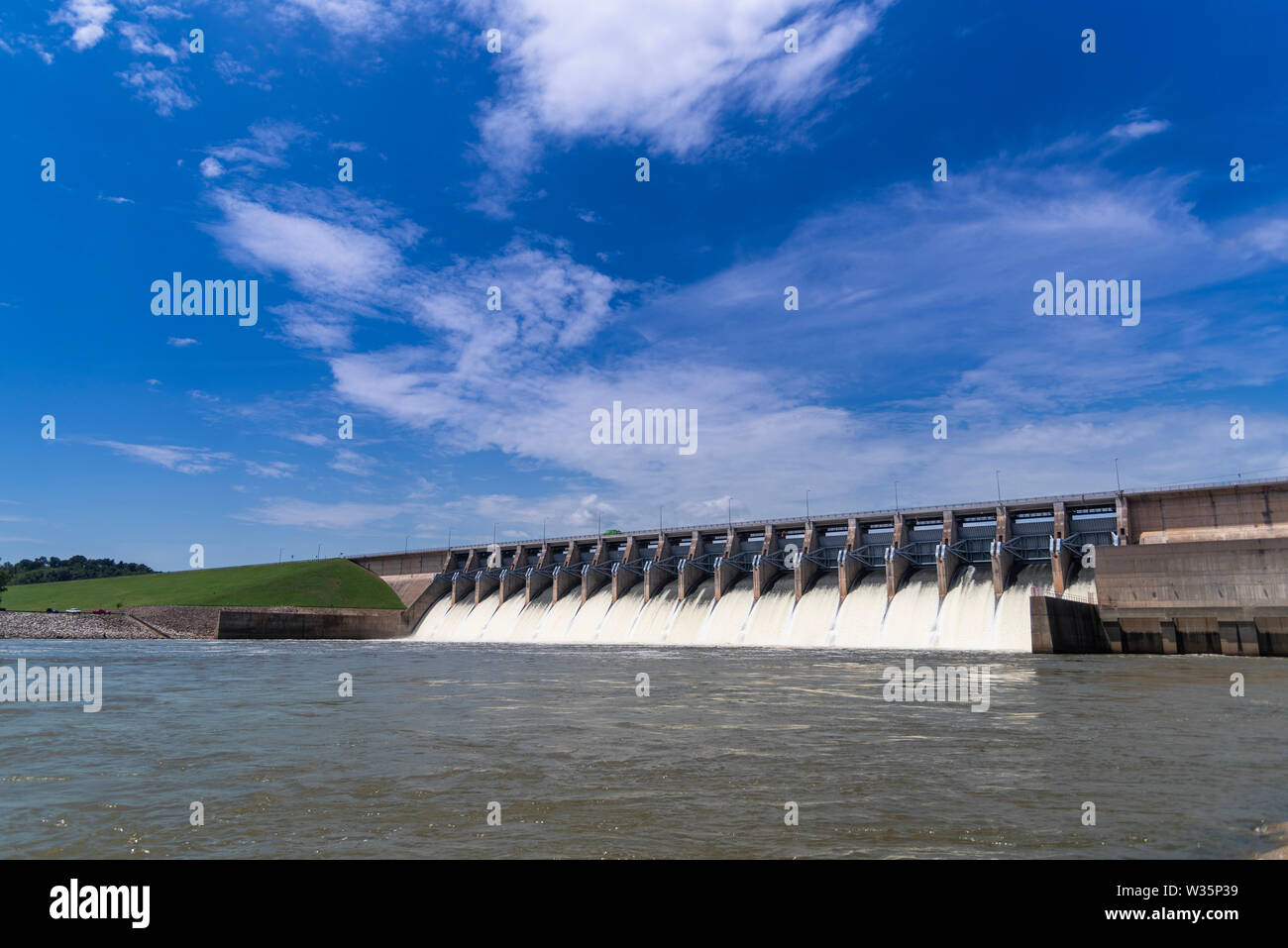 Water flowing through the open gates of a hydro electric power station Stock Photo