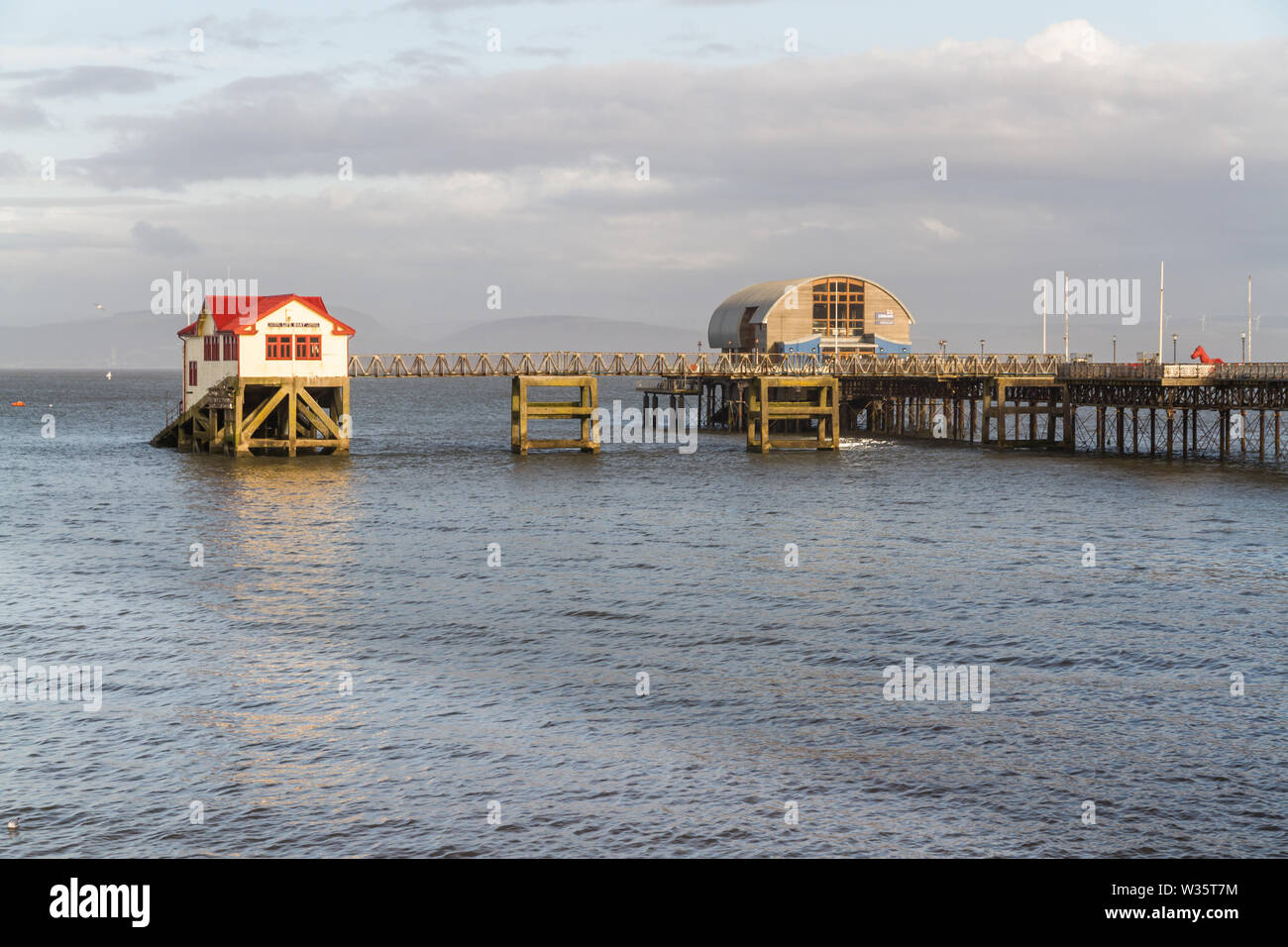 Old and new lifeboat station, The Mumbles, Swansea, Wales, afternoon light - Stock Image