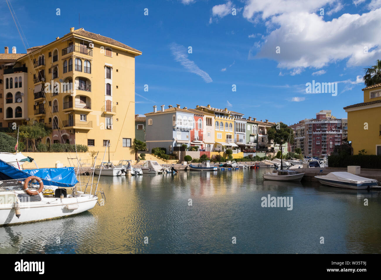 colorful houses and boats in Port Saplaya, Valencia (Spain) - Stock Image