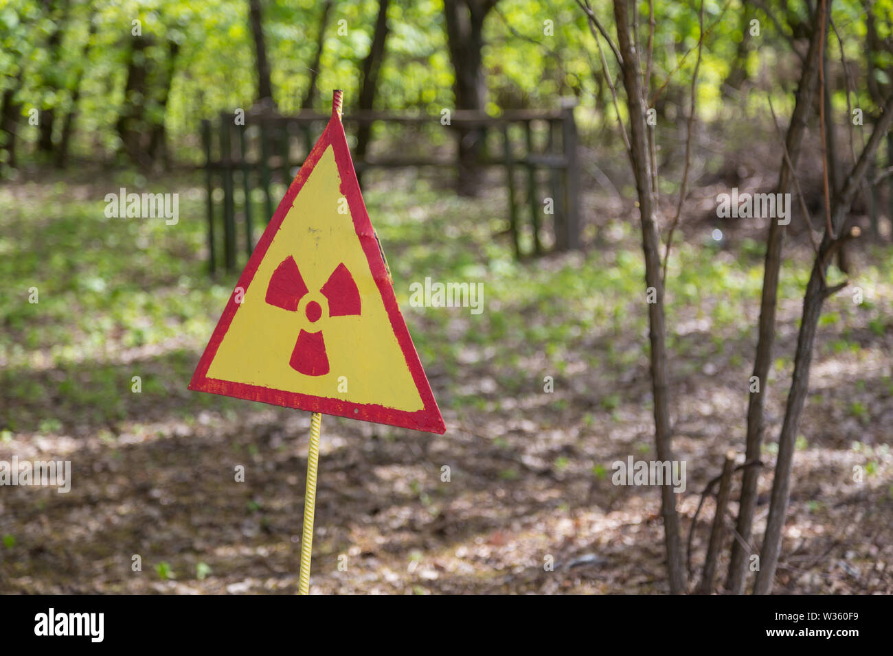 Radiation sign on a graveyard in abandoned Pripyat city in Chernobyl Exclusion Zone, Ukraine - Stock Image