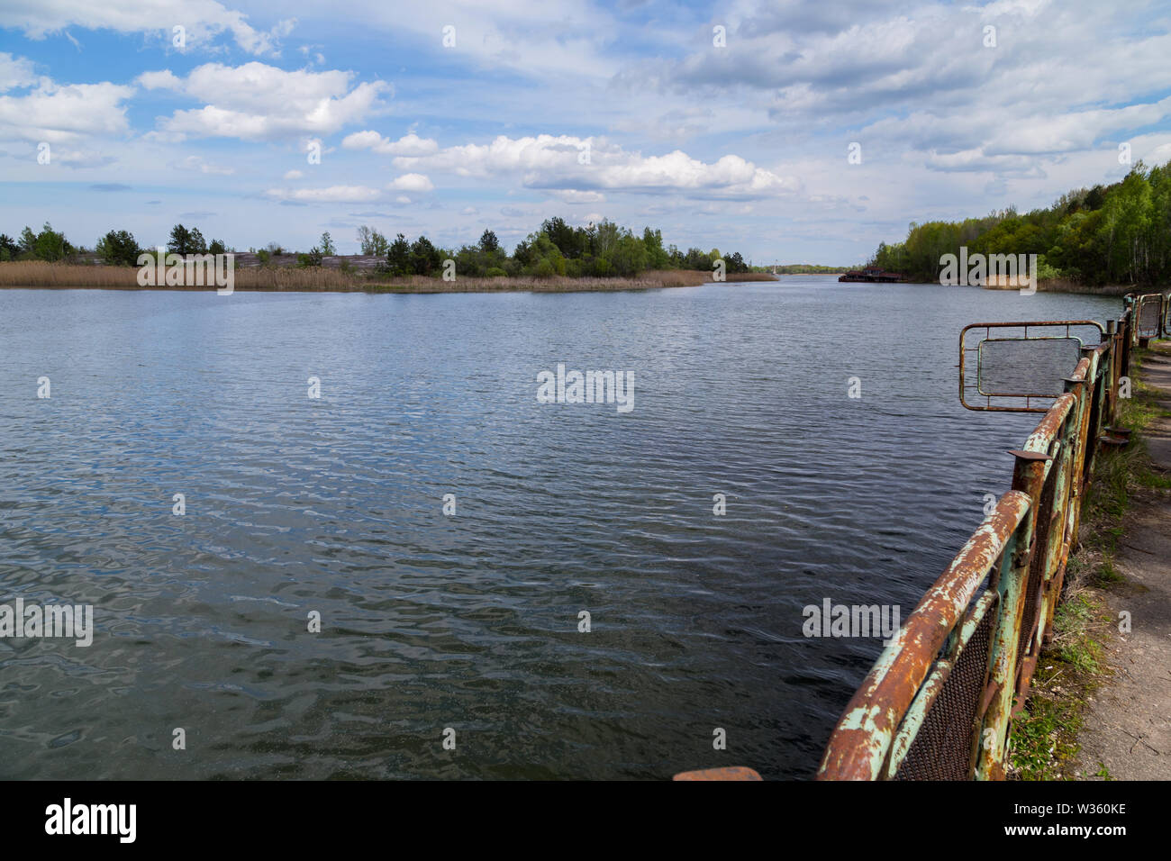 Lake in the town of Prypjat in Ukraine. Lake full of hazardous radioactive waste. after the nuclear disaster of Chernobyl - Stock Image