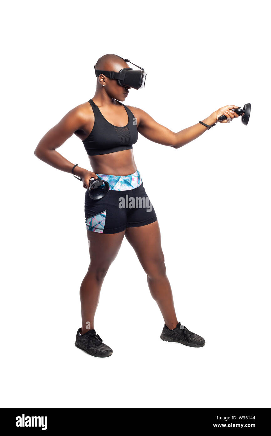 Athletic black female playing a first person shooter video game in