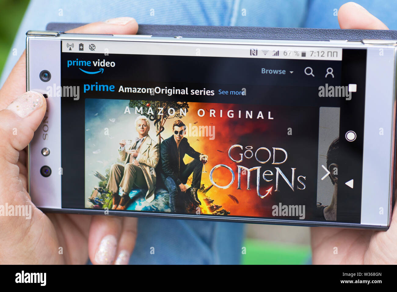 Amazon Prime Video, Prime Amazon Original Series, Good Omens Movies streaming website on Mobile Phone screen Stock Photo