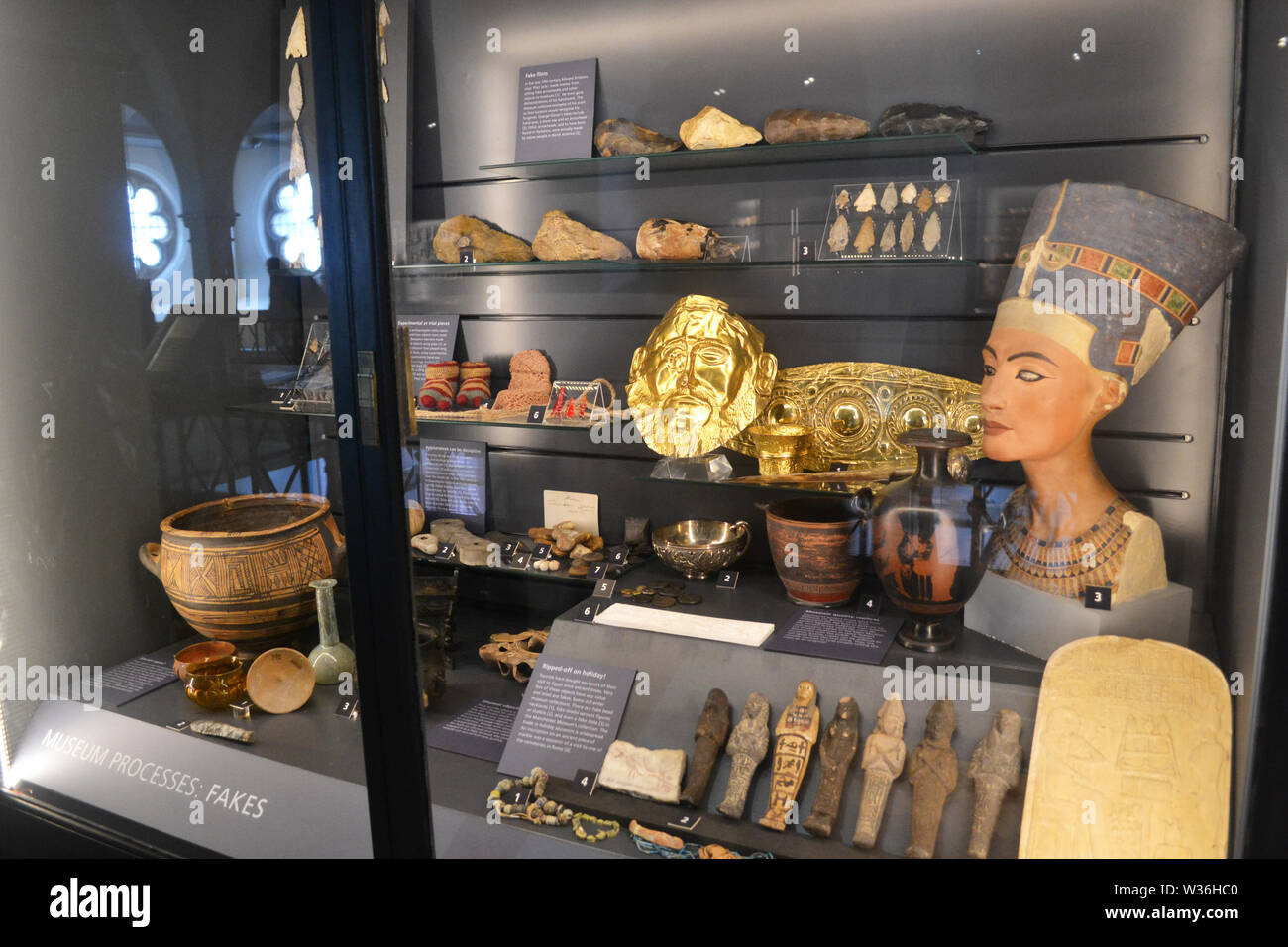 Display of fake artefacts at Manchester Museum, UK. Part of the University of Manchester - Stock Image
