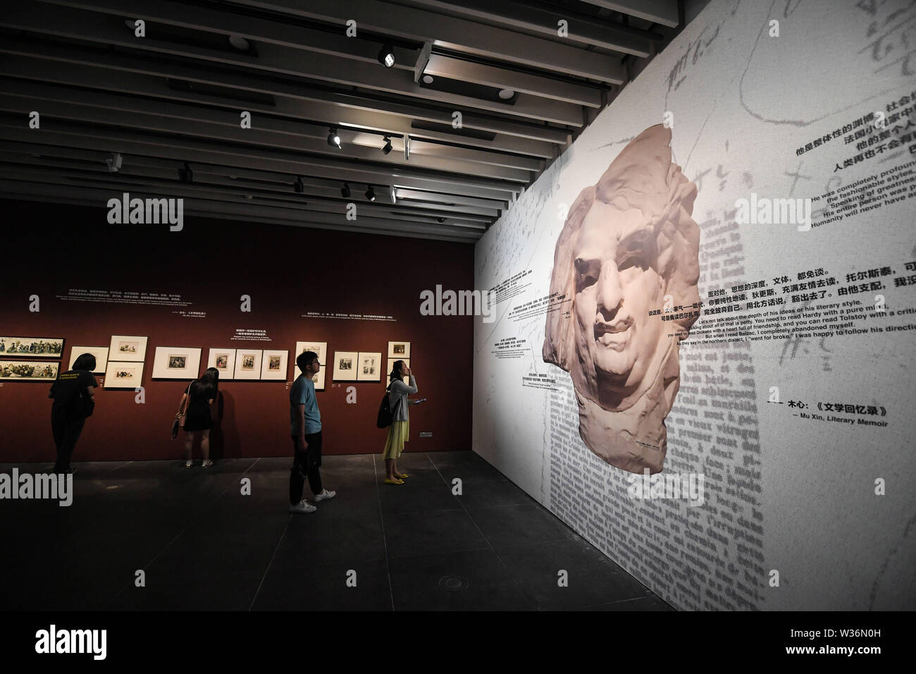 Wuzhen, China's Zhejiang Province. 13th July, 2019. People visit an exhibition that commemorates well-known French writer Honore de Balzac held at Muxin Art Museum in the Wuzhen scenic area of Tongxiang, east China's Zhejiang Province, July 13, 2019. More than 100 exhibits are on display during the exhibition that runs from July 13 to Oct. 31. Credit: Xu Yu/Xinhua/Alamy Live News - Stock Image