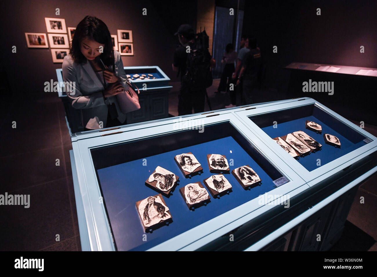 Wuzhen, China's Zhejiang Province. 13th July, 2019. A visitor views exhibits during an exhibition that commemorates well-known French writer Honore de Balzac held at Muxin Art Museum in the Wuzhen scenic area of Tongxiang, east China's Zhejiang Province, July 13, 2019. More than 100 exhibits are on display during the exhibition that runs from July 13 to Oct. 31. Credit: Xu Yu/Xinhua/Alamy Live News - Stock Image