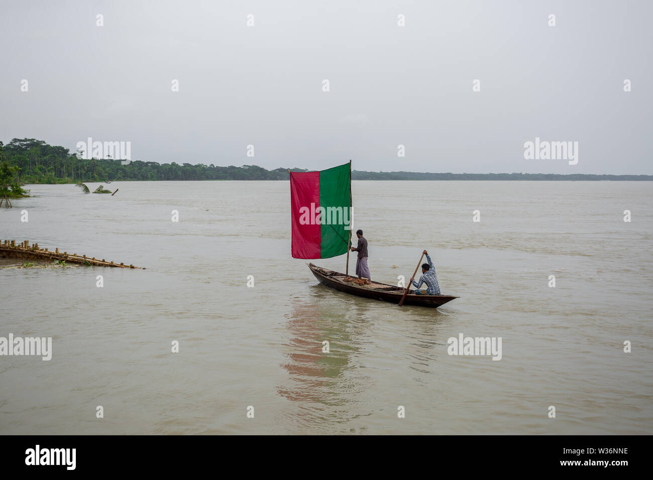 Bangladesh – June 27, 2015: A sailing liner, the water of the Kirtonkhola was flowing 5cm above the danger level of 2.55 metres at Rasulpur, Barisal D - Stock Image