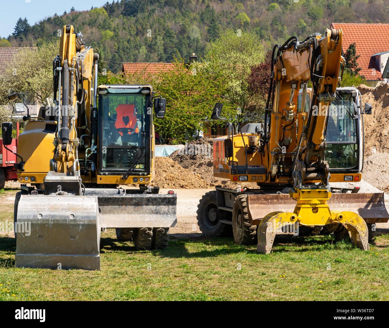 Construction site with yellow excavators - Stock Image