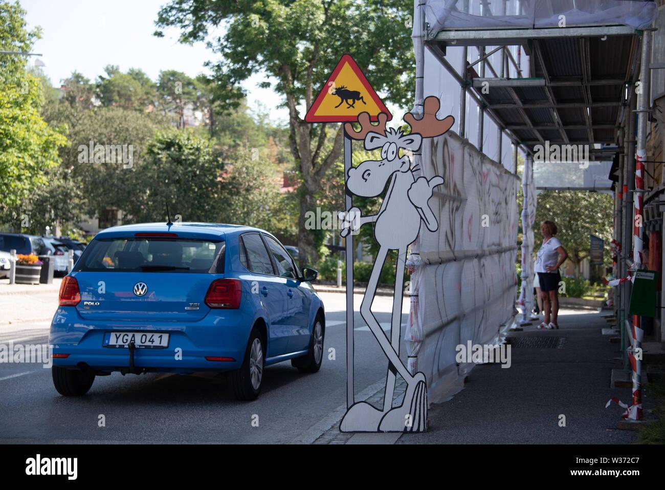 Strömstad, Sweden - July 11, 2019: View of an elk sign on a road in Strömstad, Sweden. - Stock Image
