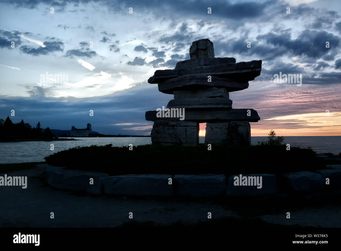 Canada Ontario Collingwood, Inukshuk at Sunset Point at sunset, June 2019, Inushuk Stone Landmark, we were here, Stock Photo