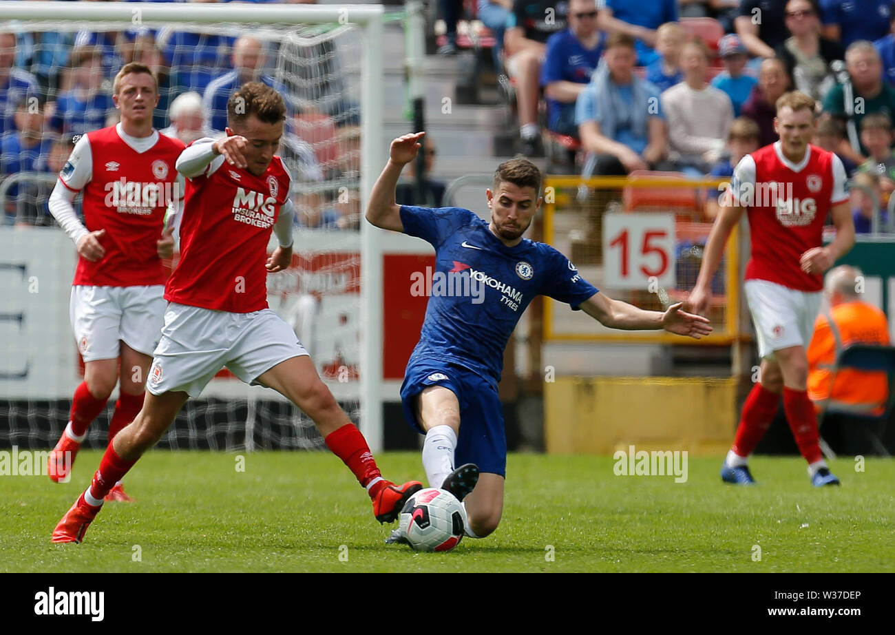 Richmond Park, Dublin, Ireland. 13th July, 2019. Pre season football friendly, St Patricks versus Chelsea; Jorginho of Chelsea and Darragh Markey of St Patricks Athletic challenge for the ball Credit: Action Plus Sports/Alamy Live News Stock Photo