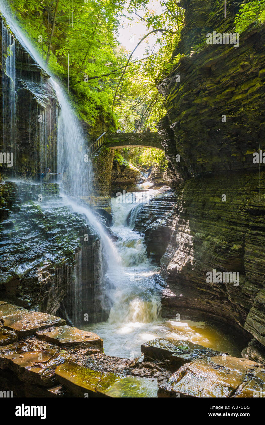 Soothing waterfall along the hiking trails at Watkins Glen State Park - Stock Image