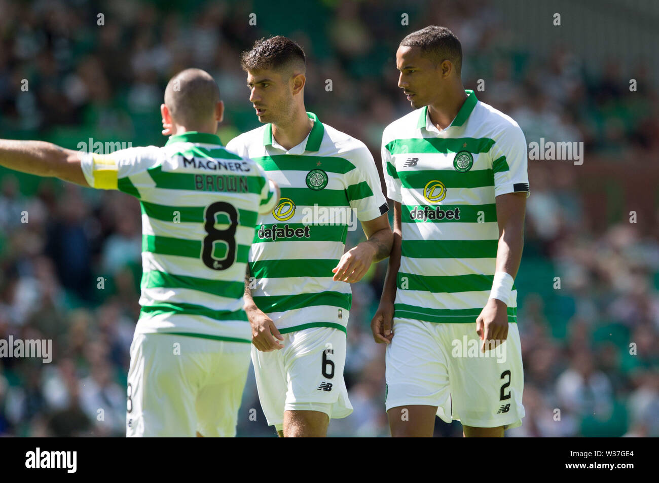 Celtic's Christopher Jullien (right) with Scott Brown and Nir Bitton during the pre-season friendly match at Celtic Park, Glasgow. - Stock Image