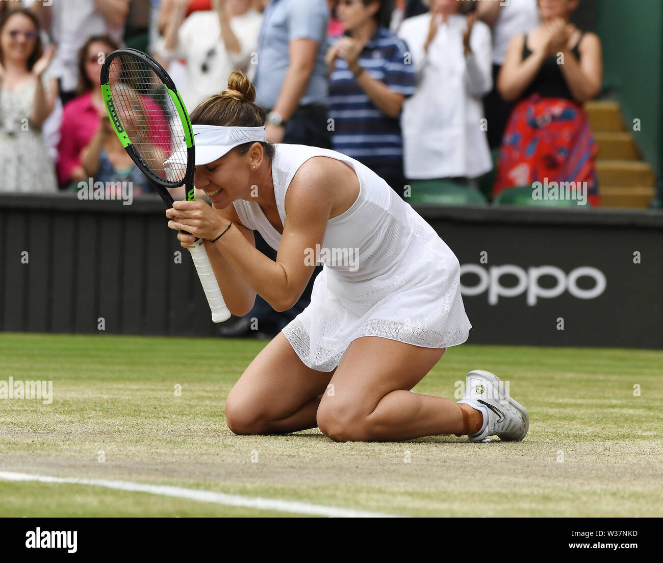 London, UK. 13th July, 2019. The Championships Wimbledon 2019 13072019 Simona Halep sinks to her knees as she wins Ladies Singles Final Credit: Roger Parker/Alamy Live News - Stock Image