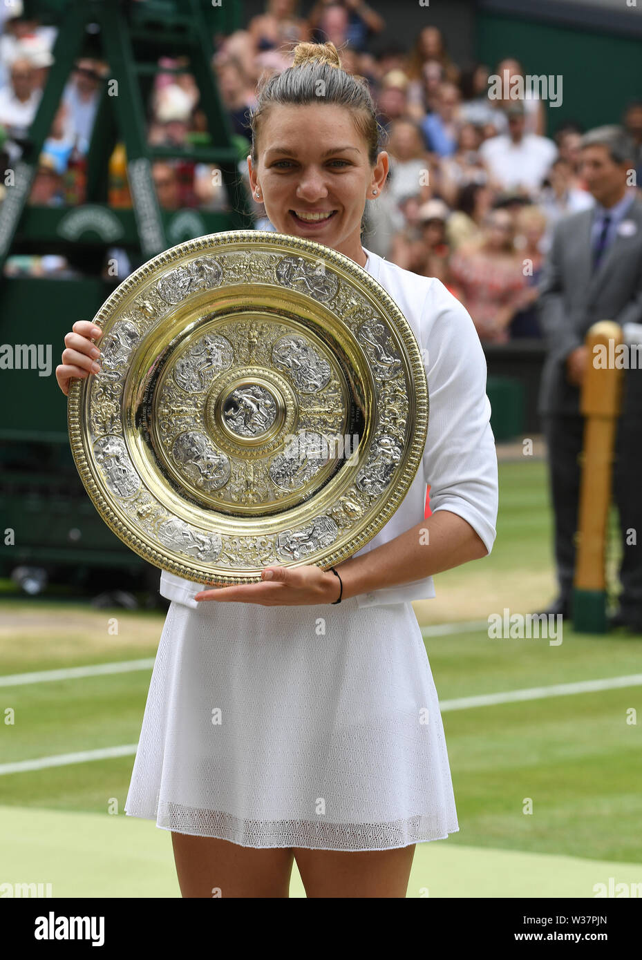 London, UK. 13th July, 2019. The Championships Wimbledon 2019 13072019 Simona Halep with winners trophy Venus rosewater Dish after she wins Ladies Singles Final Credit: Roger Parker/Alamy Live News - Stock Image