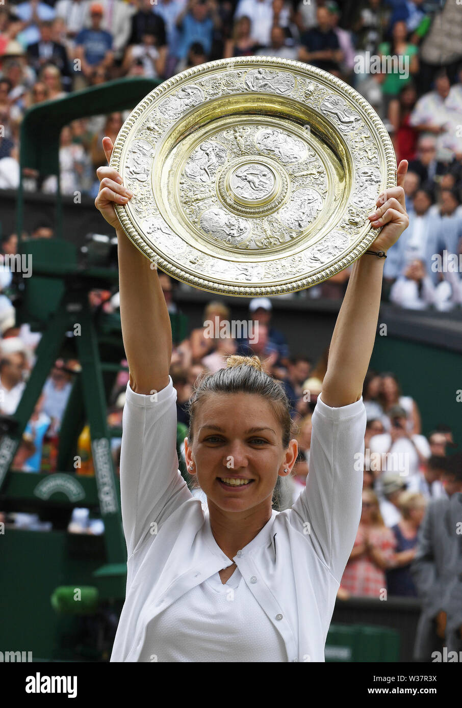 London, UK. 13th July, 2019. The Championships Wimbledon 2019 13072019 Simona Halep lifts winners trophy the Venus rosewater Dish after she wins Ladies Singles Final Credit: Roger Parker/Alamy Live News - Stock Image