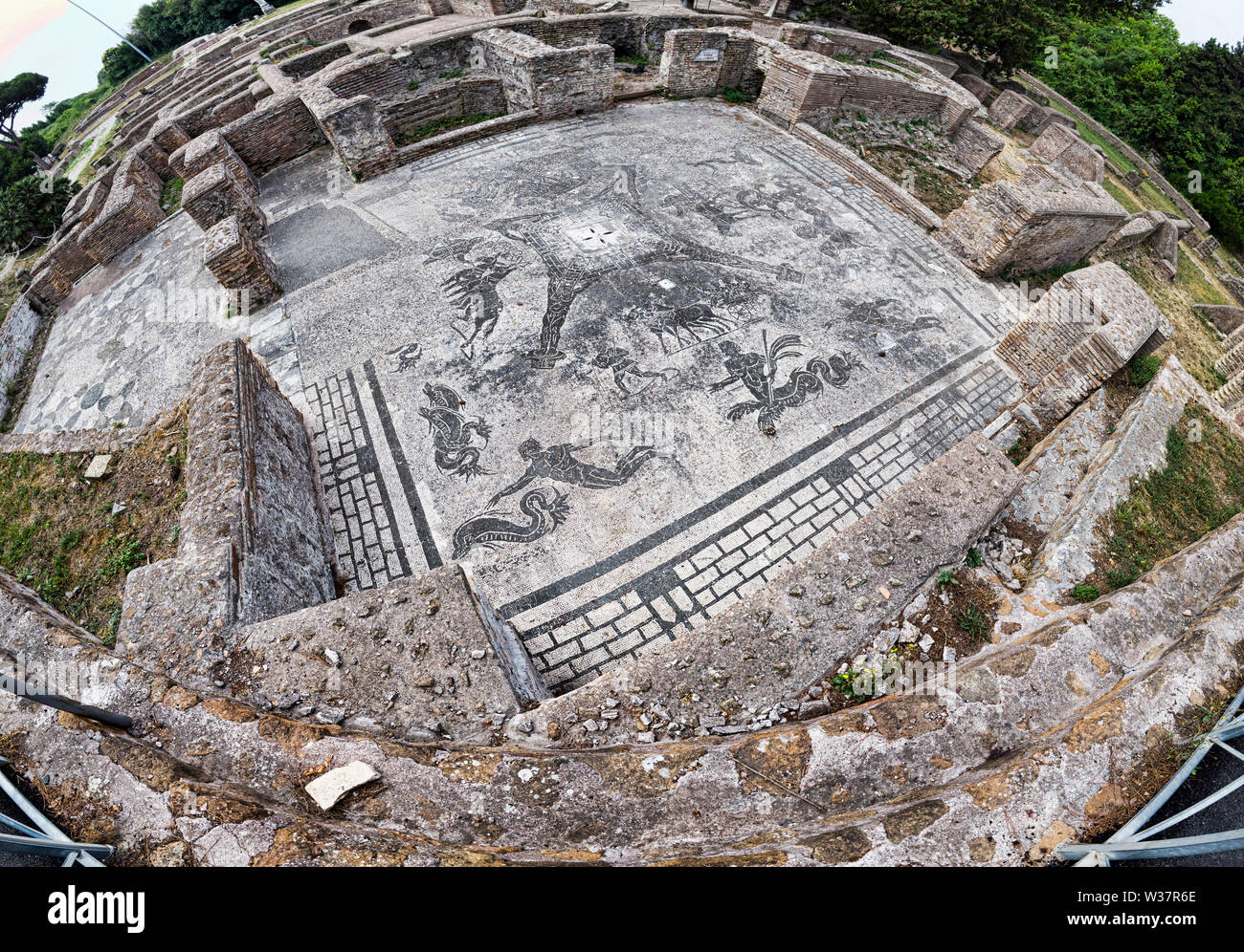 Panoramic view in the Roman empire excavation ruins at Ostia Antica with the beautiful mosaic of  Cisiarii thermal spa - Rome Stock Photo