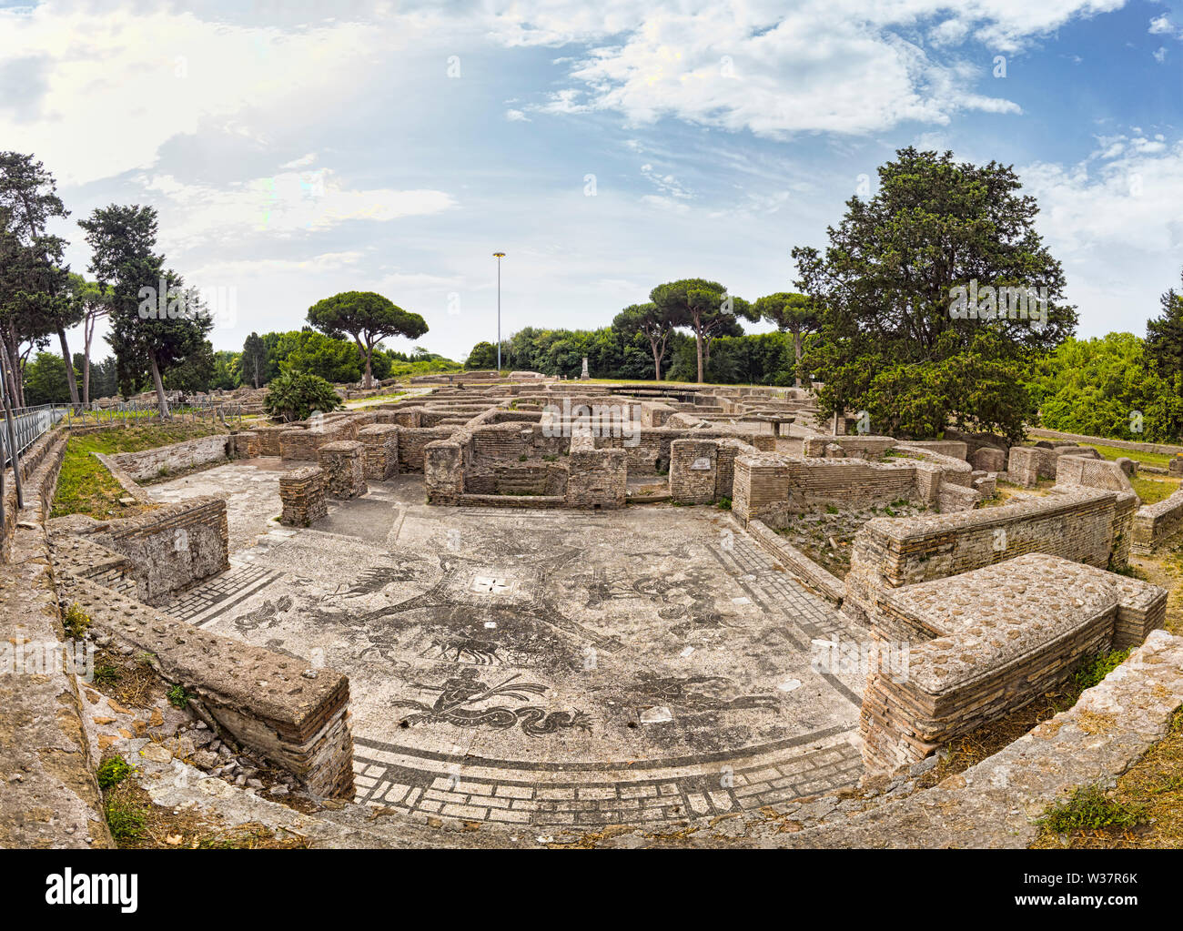 Awesome panoramic view in the Roman empire excavation ruins at Ostia Antica with the beautiful mosaic of  Cisiarii thermal spa and it's architecture - Stock Photo