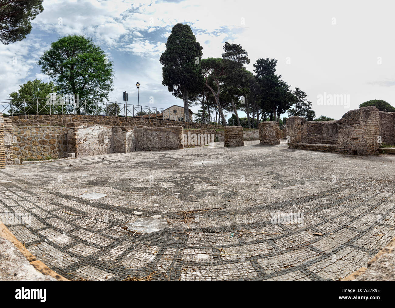 Panoramic view of the frigidarium in the Cisiarii thermal spa in the archaeological site of Ostia Antica - Roma Stock Photo