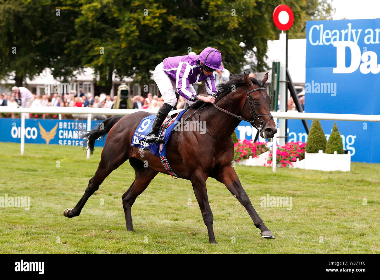 Ten Sovereigns ridden by jockey Ryan Moore wins the Darley July Cup Stakes during day three of the Moet and Chandon July Festival 2019 at Newmarket Racecourse. - Stock Image