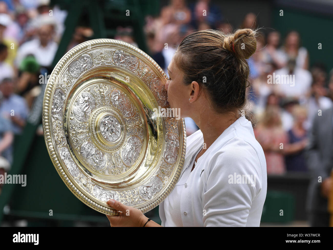 London, UK. 13th July, 2019. The Championships Wimbledon 2019 13072019 Simona Halep with winners trophy the Venus rosewater Dish after she wins Ladies Singles Final Credit: Roger Parker/Alamy Live News - Stock Image