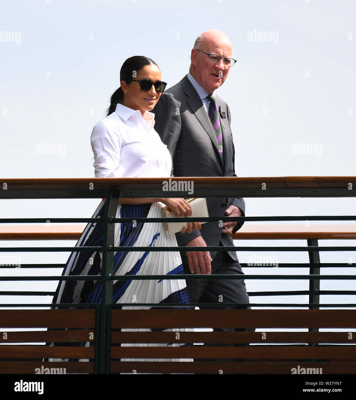 London, UK. 13th July, 2019.  The Championships Wimbledon 2019 13072019  Meghan Duchess of Sussex crosses the players walkway after Simona Halep wins Ladies Singles Final Photo Roger Parker International Sports Fotos Ltd/Alamy Live News - Stock Image
