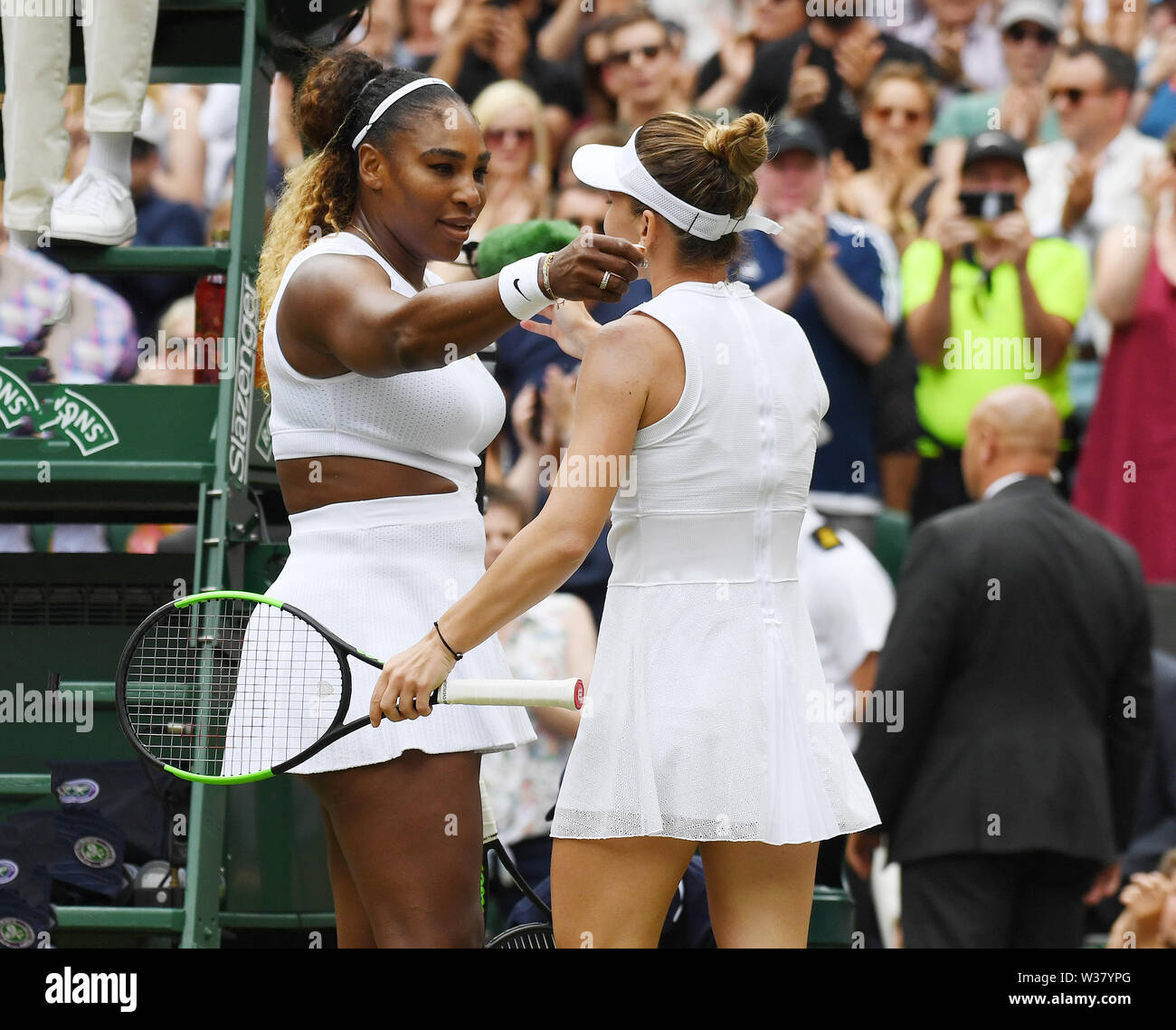 London, UK. 13th July, 2019.  The Championships Wimbledon 2019 13072019 Simona Halep  is congratulated by Serena Williams after she wins Ladies Singles Final Photo Roger Parker International Sports Fotos Ltd/Alamy Live News - Stock Image