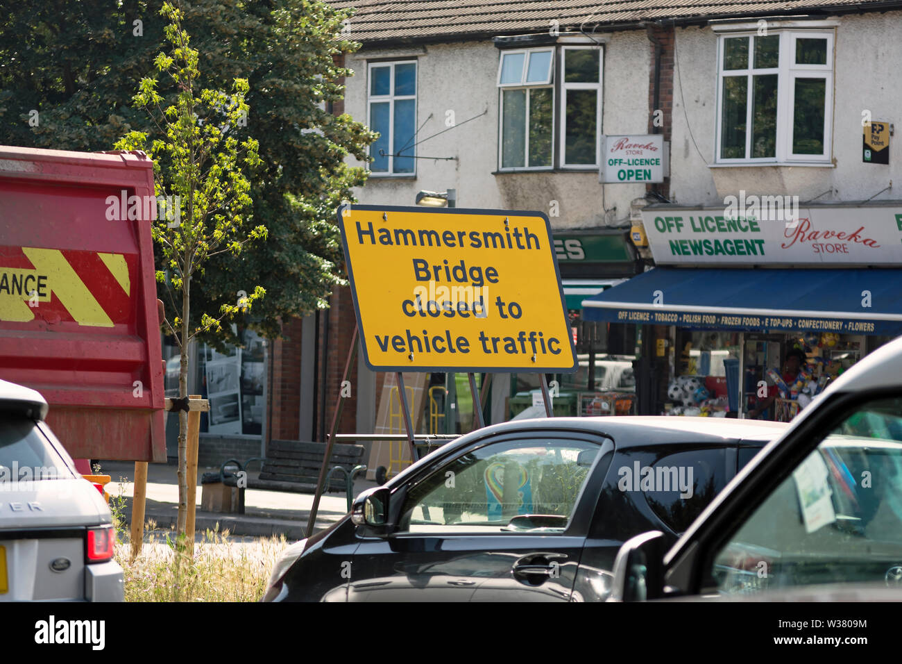 viewed across queueing traffic, hammersmith bridge closed to vehicular traffic sign on the south circular in southwest london, england Stock Photo