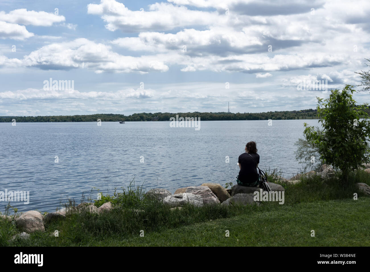 Canada Ontario Barrie at June 2019, Lunch break in the park, a woman is reading - Stock Image