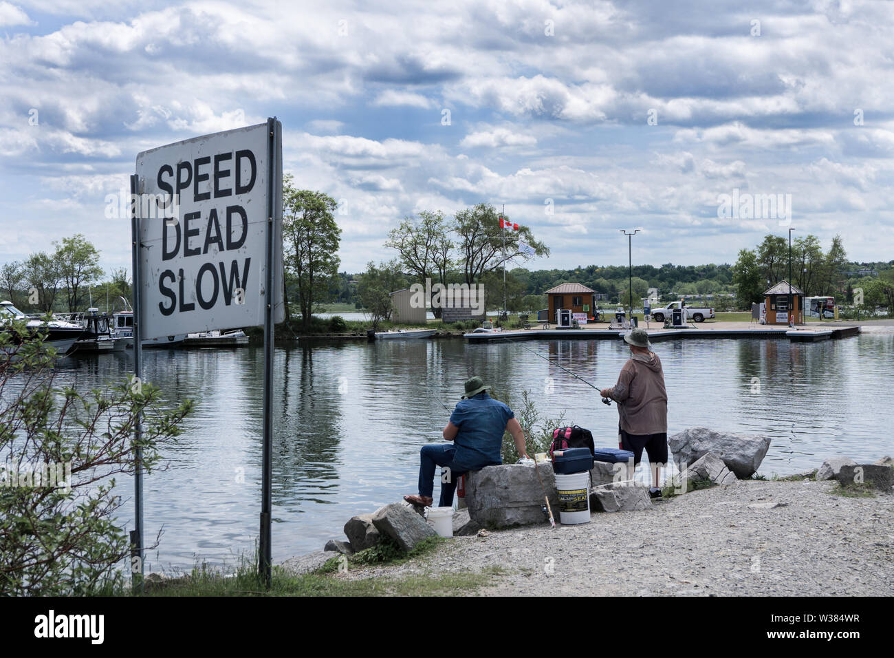 Canada Ontario Barrie at June 2019, Marina Kempenfelt Bay Yacht Club, Two fishermen try their luck - Stock Image
