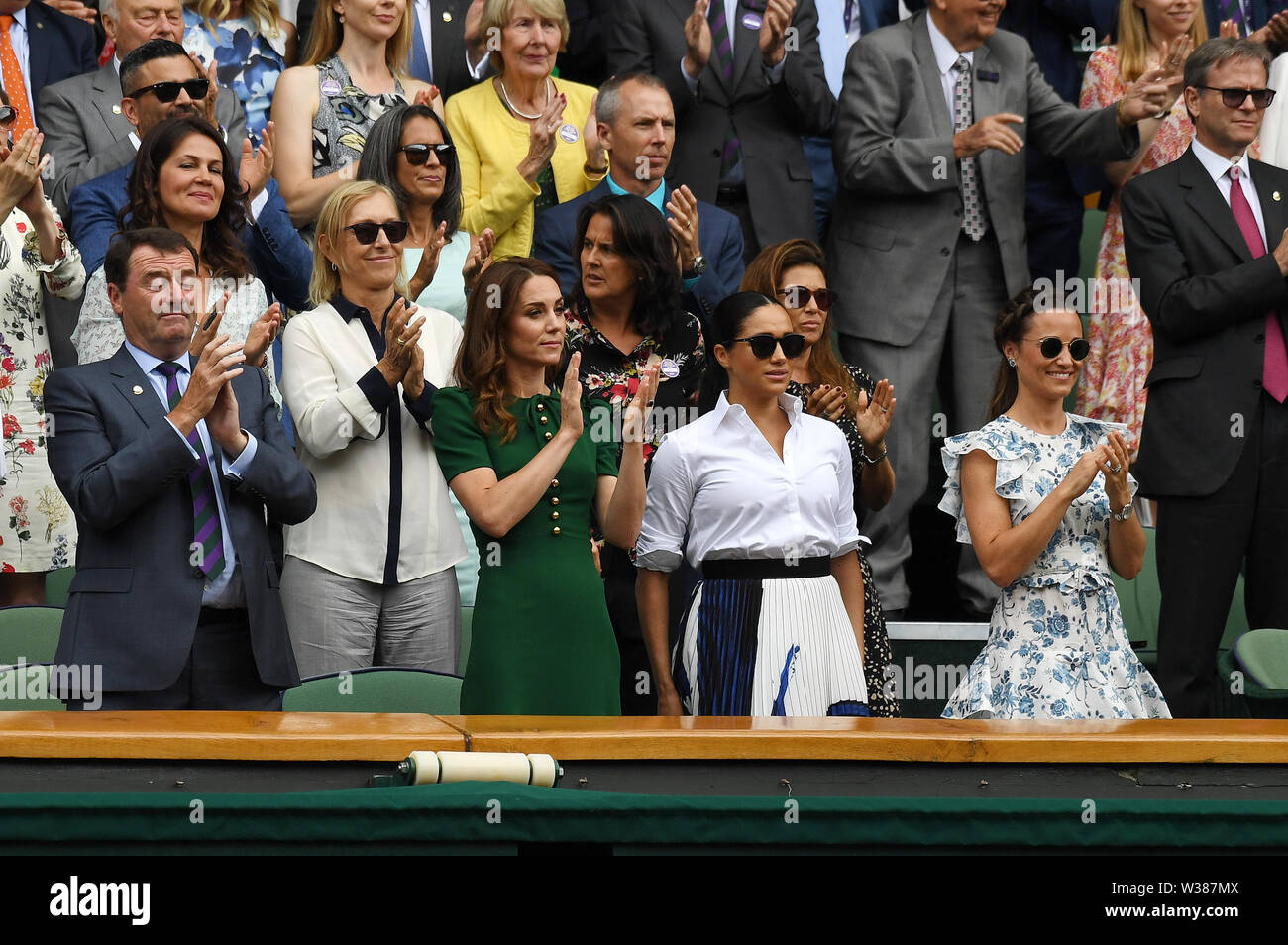 London England  13 July 2019 The Championships Wimbledon 2019 13072019  Everyone in Royal box, Katherine Duchess of Cambridge and Pippa Matthews applaud from the  Royal Box after Simona Halep wins Ladies Singles Final but  Meghan Duchess of Sussex does not join in. Photo Roger Parker International Sports Fotos Ltd/Alamy Live News - Stock Image