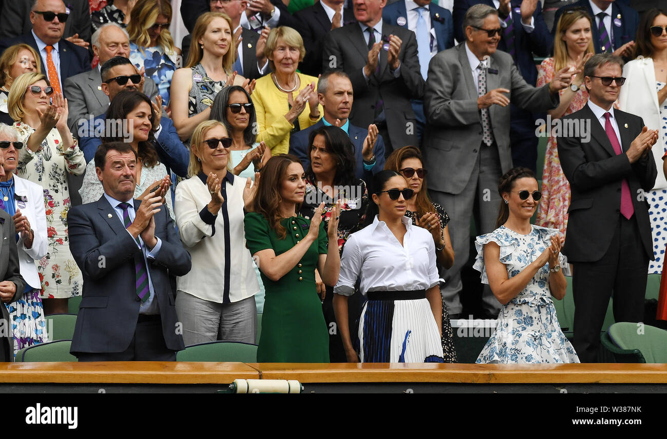 London England  13 July 2019 The Championships Wimbledon 2019 13072019  Everyone in Royal Box including Katherine Duchess of Cambridge and Pippa Matthews applaud from the  Royal Box after Simona Halep wins Ladies Singles Final but  Meghan Duchess of Sussex does not join in. Photo Roger Parker International Sports Fotos Ltd/Alamy Live News - Stock Image