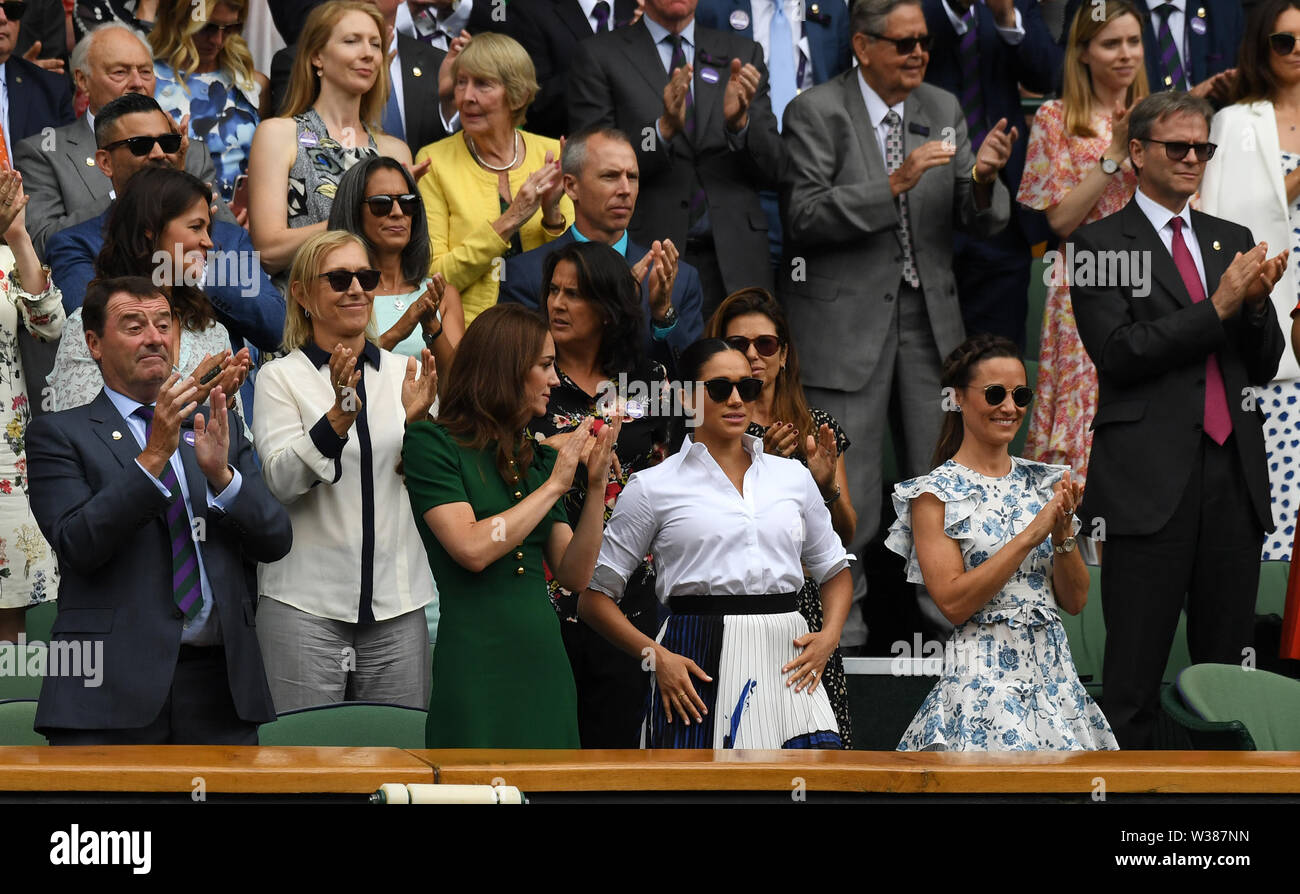 London England  13 July 2019 The Championships Wimbledon 2019 13072019  Katherine Duchess of Cambridge looks to the Duchess of Sussex as all of the Royal box except her including Pippa Matthews applaud from the  Royal Box after Simona Halep wins Ladies Singles Final Photo Roger Parker International Sports Fotos Ltd/Alamy Live News - Stock Image