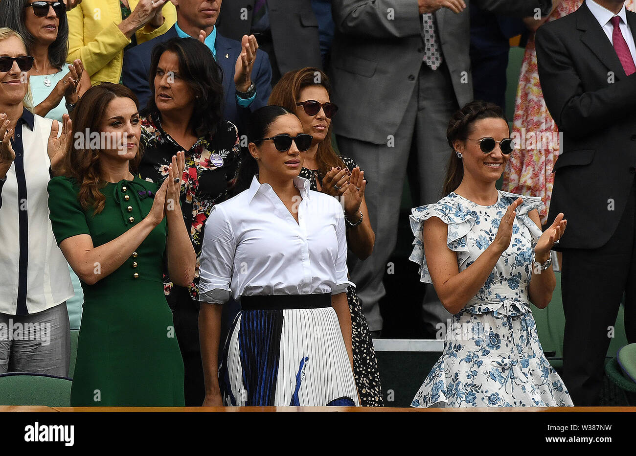 London England  13 July 2019 The Championships Wimbledon 2019 13072019  Katherine Duchess of Cambridge and Pippa Matthews applaud from the  Royal Box after Simona Halep wins Ladies Singles Final but  Meghan Duchess of Sussex does not join in. Photo Roger Parker International Sports Fotos Ltd/Alamy Live News - Stock Image