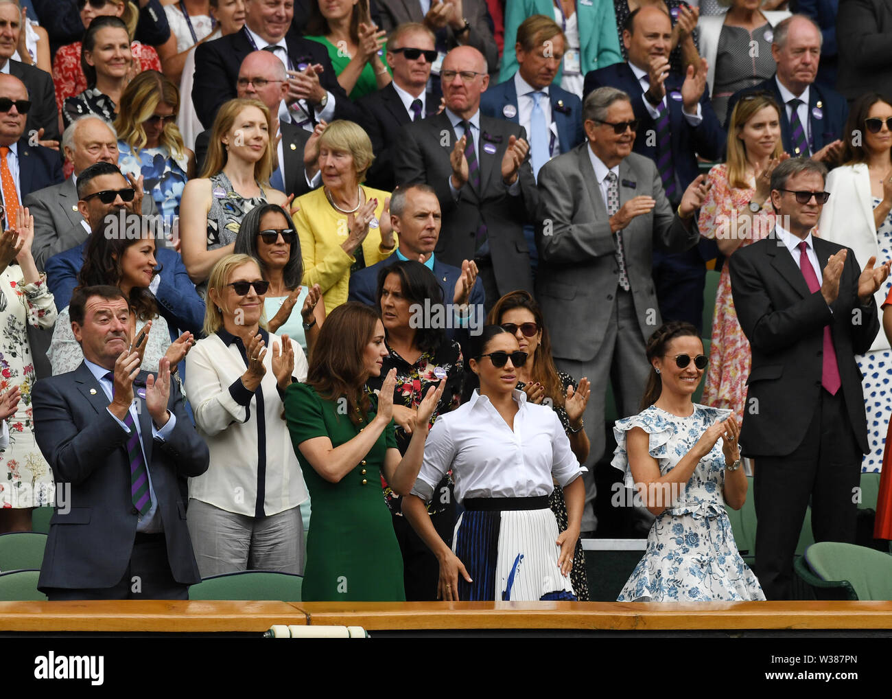 London England  13 July 2019 The Championships Wimbledon 2019 13072019  Everyone in the Royal Box, including Katherine Duchess of Cambridge and Pippa Matthews applaud from the  Royal Box after Simona Halep wins Ladies Singles Final but  Meghan Duchess of Sussex does not join in. Photo Roger Parker International Sports Fotos Ltd/Alamy Live News - Stock Image
