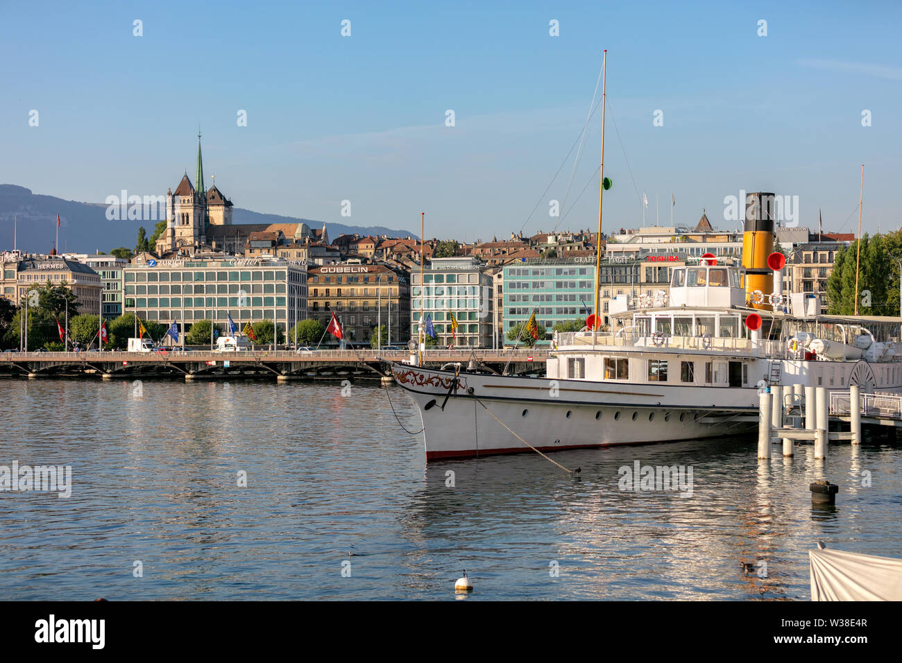 Downtown of Geneva and the steamer boat in the port on lake Geneva - Stock Image