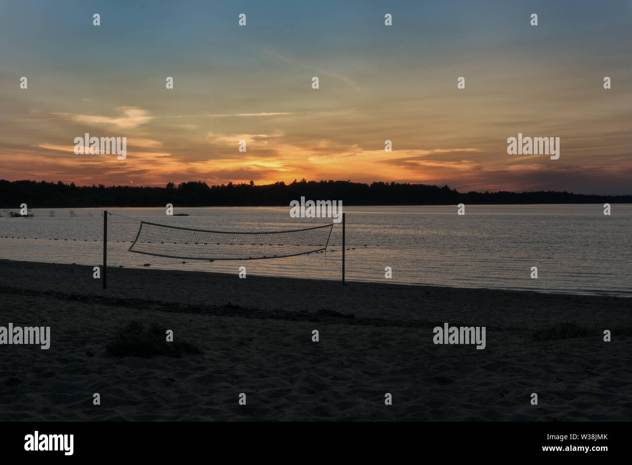 A beautiful sunset at Black Bear Beach, Canada, Petawawa, in the foreground a volleyball net, Stock Photo