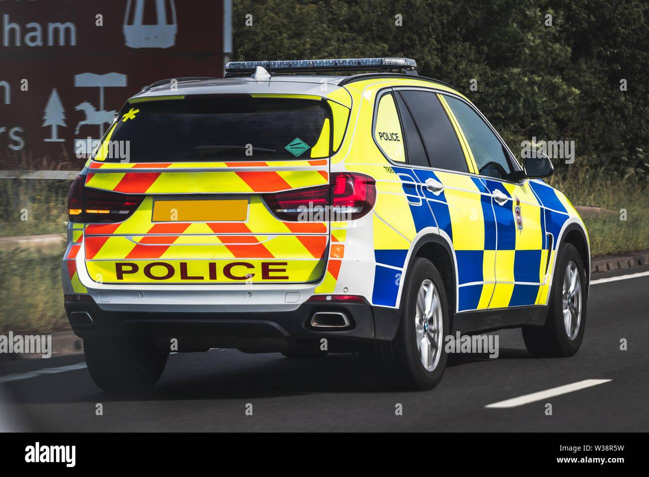 Marked Police 4x4 Responding to emergency speeding down motorway. Stock Photo