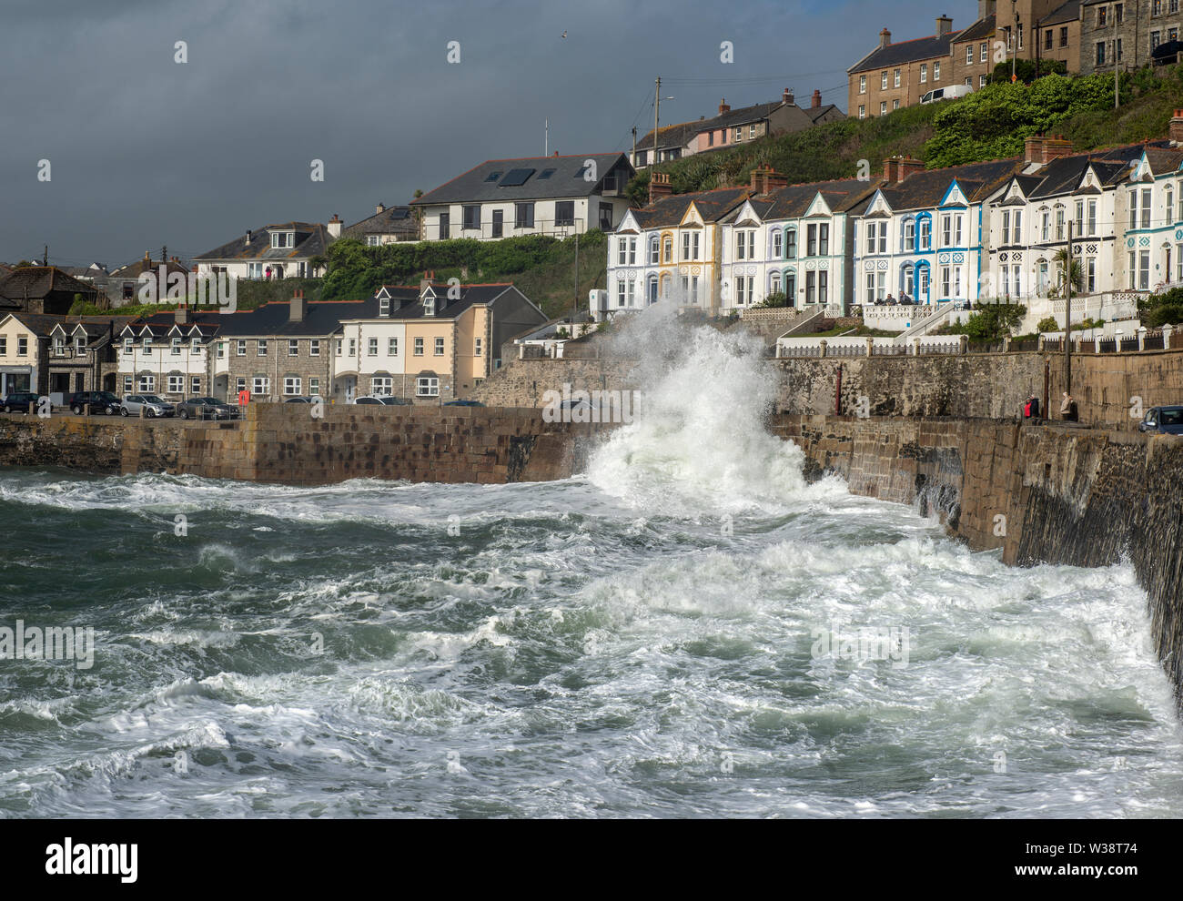 Waves crashing over the harbour wall at Porthleven in Cornwall, England, UK Stock Photo