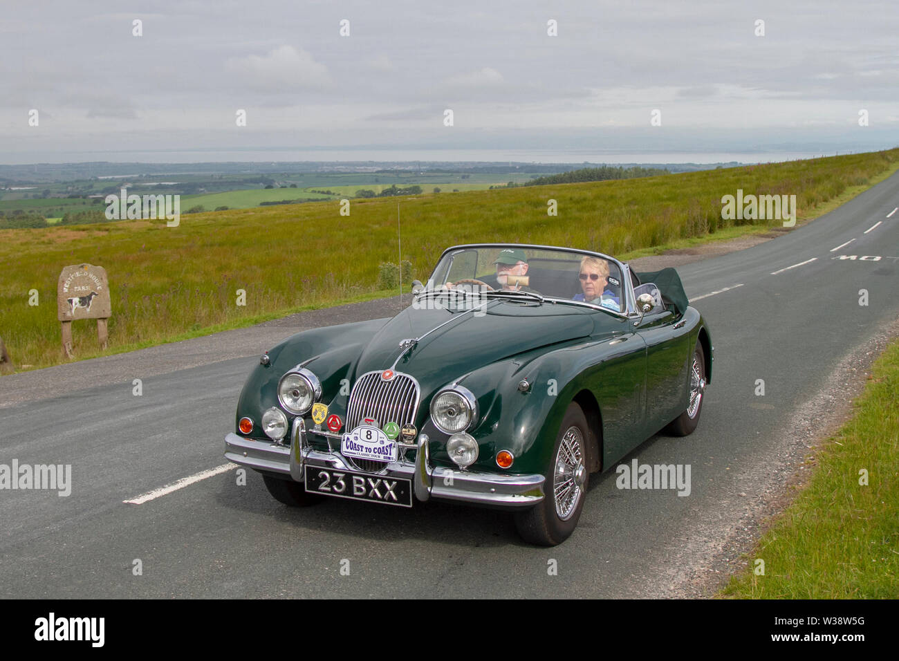 Jaguar XK150 DHC at Scorton, Lancashire. UK Weather 13th July, 2019. Sunny conditions as the Lancashire Car Club Rally Coast to Coast crosses the Trough of Bowland. 74 vintage, classic, collectible, heritage, historics vehicles left Morecambe heading for a cross county journey over the Lancashire landscape to Whitby. A 170 mile trek over undulating landscape as part of the classics on tour car club annual event. Credit: MediaWorldImages/Alamy Live News Stock Photo