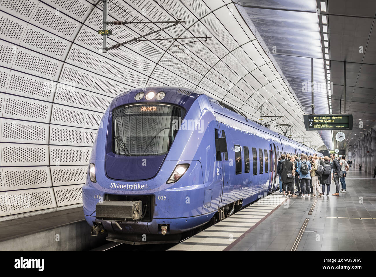 People embark a train at the underground station Triangeln in Malmo, May 21, 2019 - Stock Image