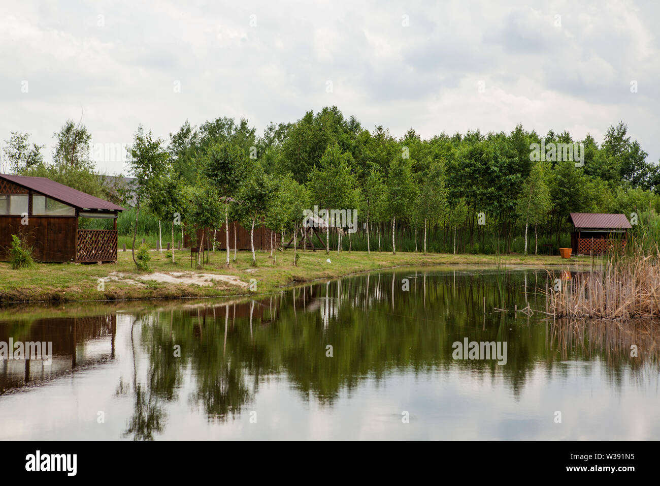 Holiday house near the lake. The concept of fishing and recreation. - Stock Image