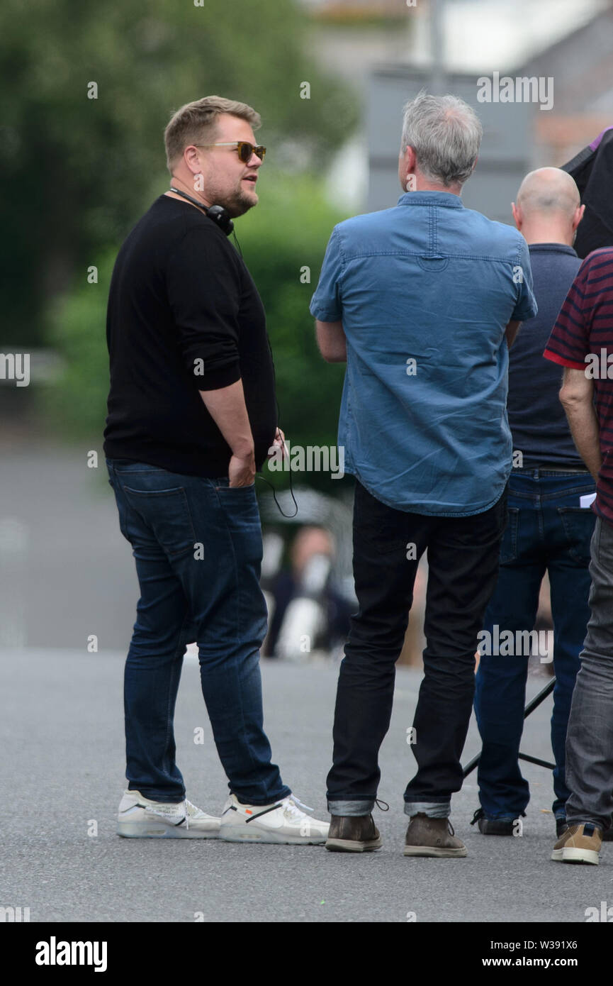 """Barry, UK. 13th July, 2019. Co-writer and star James Corden who plays """"Smithy"""" on the set of the BBC Comedy Gavin & Stacey Christmas special which is filming in Trinity Street, Barry, South Wales. Credit: Mark Lewis/Alamy Live News Stock Photo"""