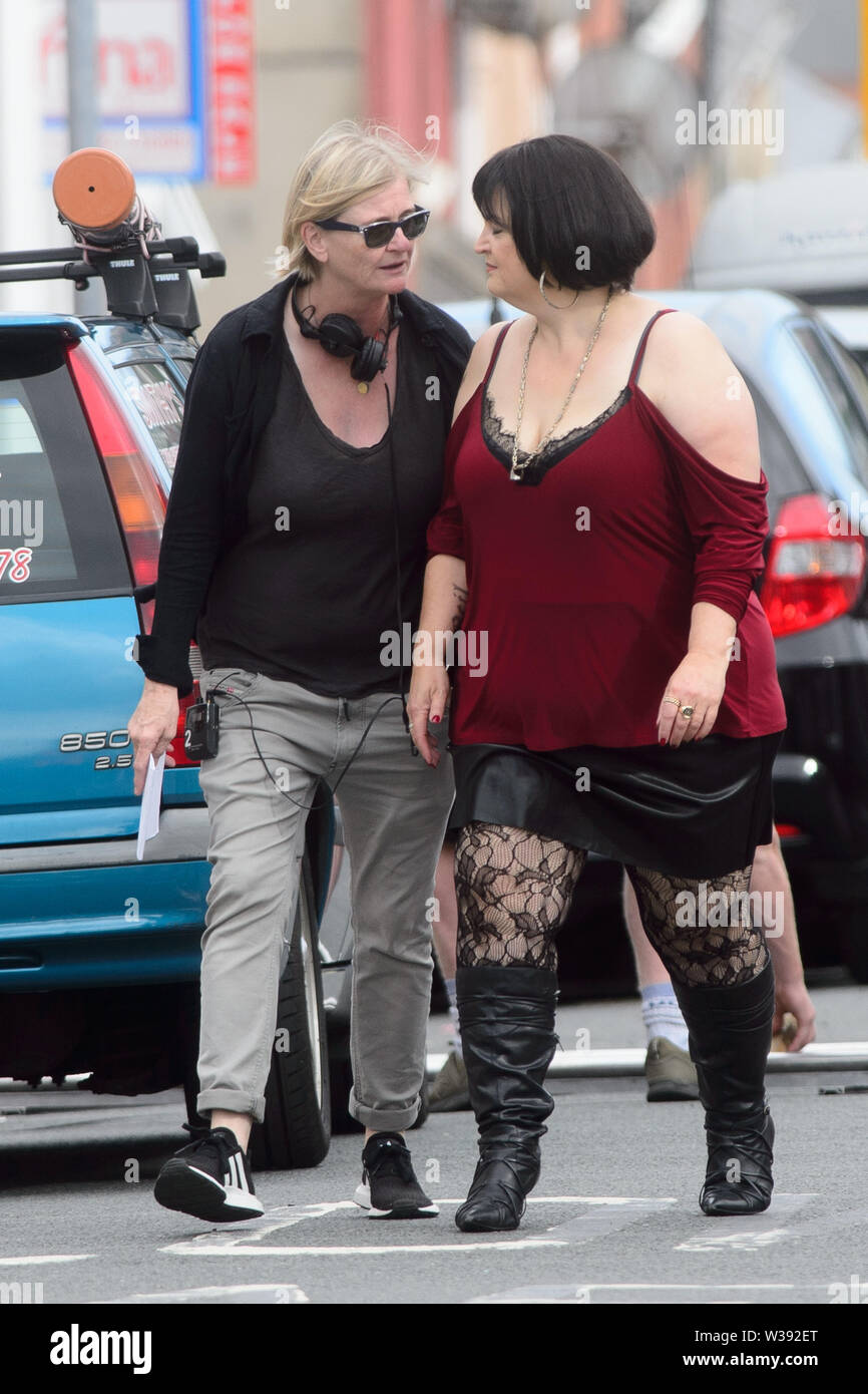 """Barry, UK. 13th July, 2019.  Co-writer Ruth Jones who plays """"Nesa"""" during filming of the BBC comedy Gavin & Stacey Christmas special in Trinity Street, Barry, South Wales. Credit: Mark Lewis/Alamy Live News Stock Photo"""
