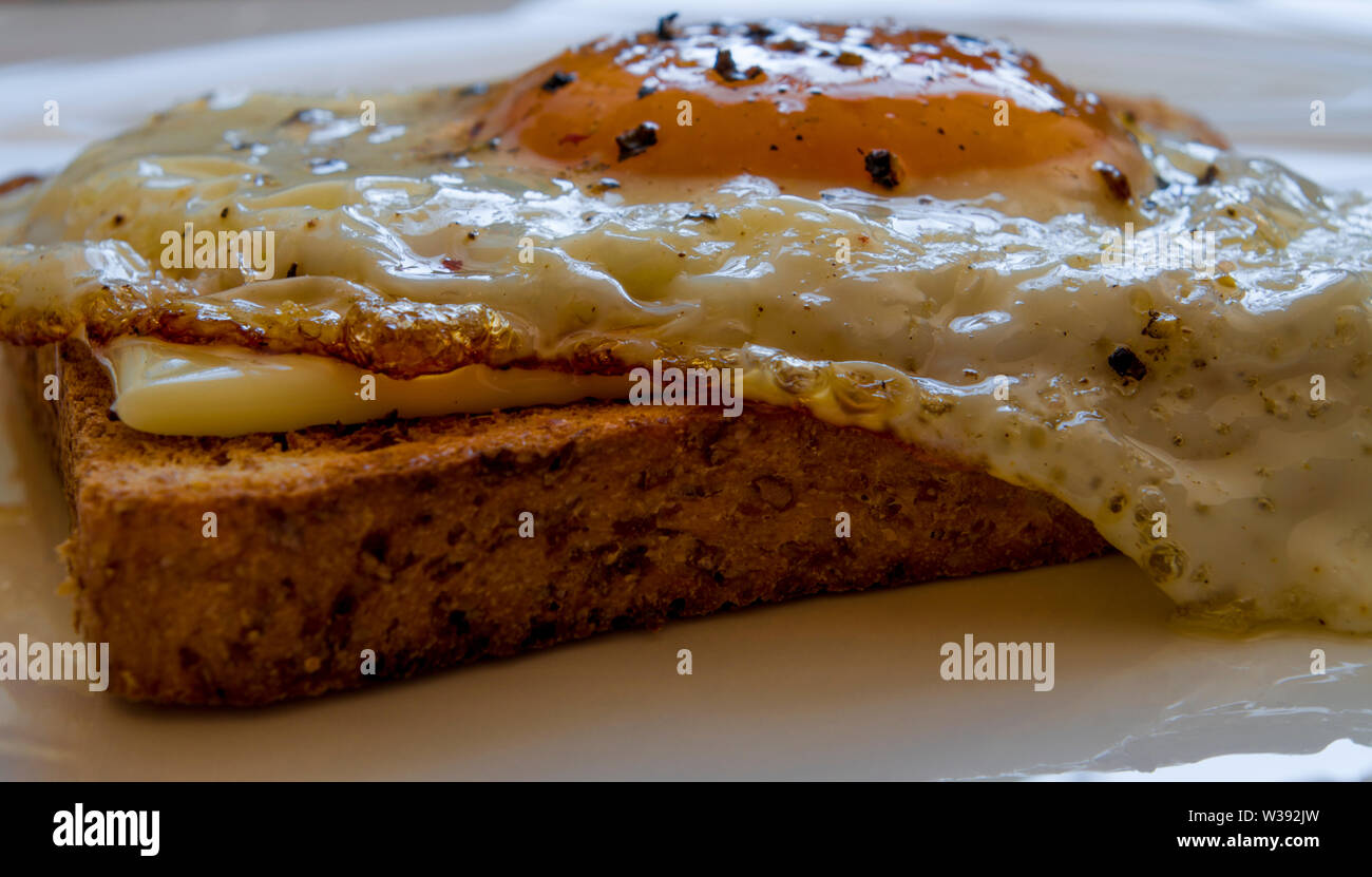 Toast with egg and cheese, fast breakfast or snack. - Stock Image