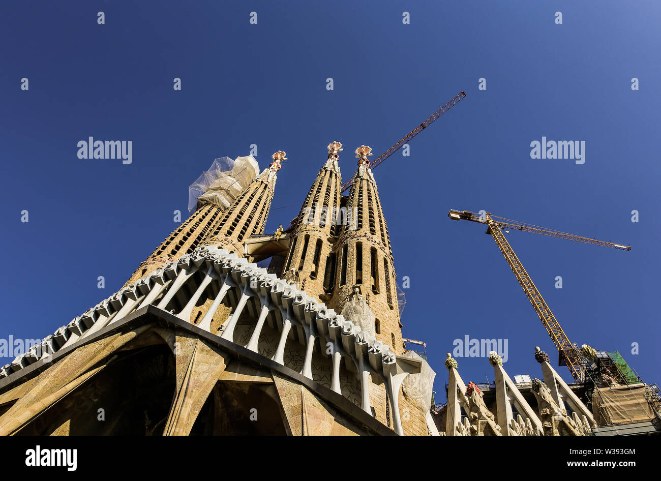 Barcelona, Spain. November 14, 2017. Entrance to the Sagrada Family by Gaudi, Basilica in sunny day, no people, against the sky, no clouds, close-up - Stock Image