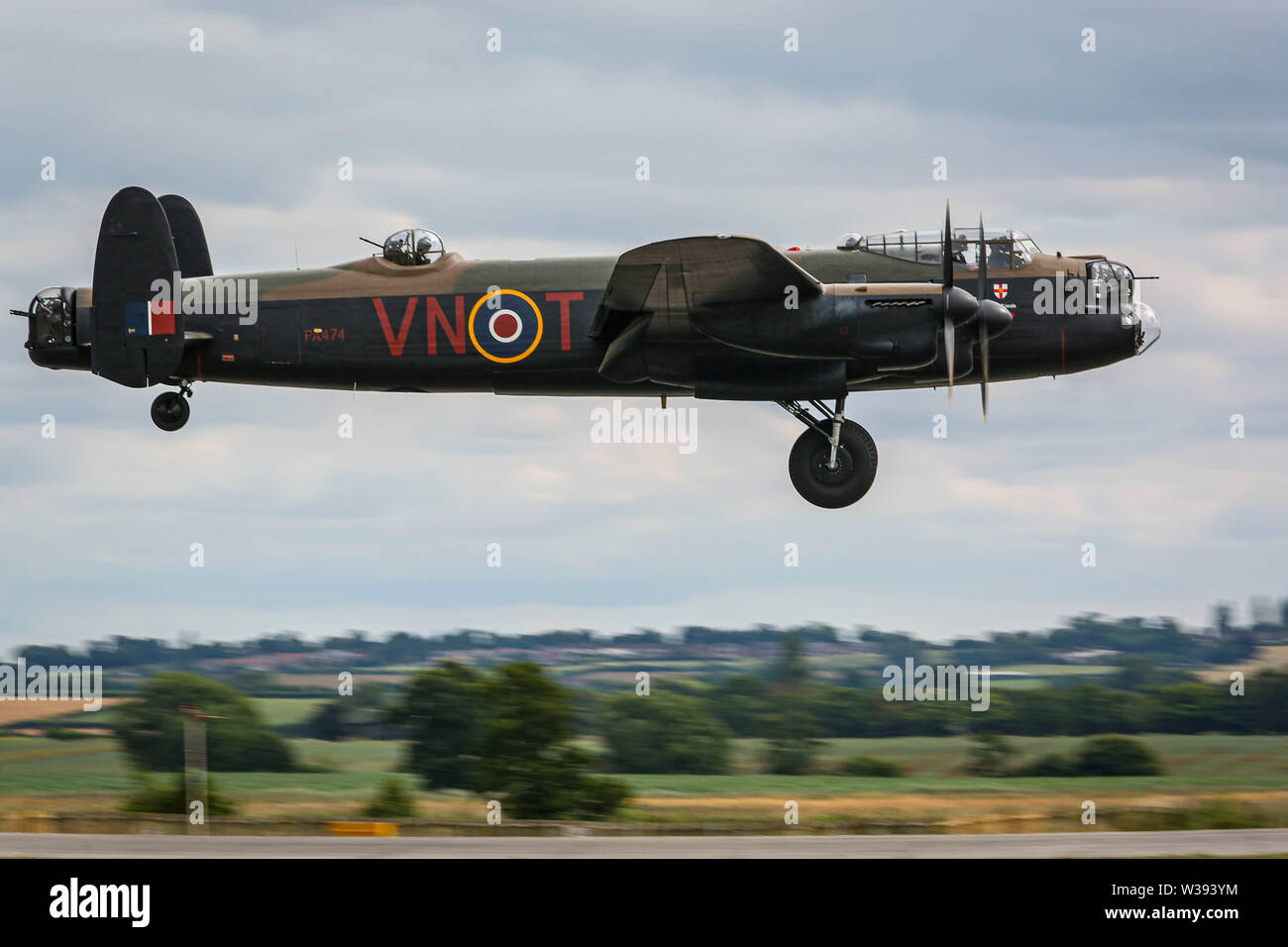 Yeovilton, UK. 13th July, 2019. A Lancaster Bomber of the Battle of Britain Memorial Flight, landing at the airshow in Yeovilton. Credit: Matthew Lofthouse/Alamy Live News Stock Photo