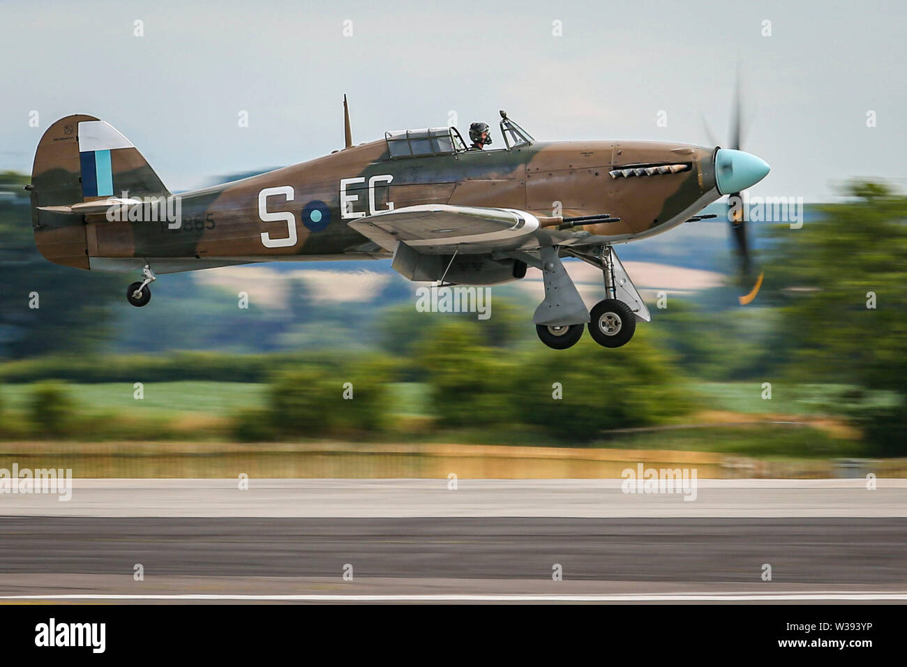 Yeovilton, UK. 13th July, 2019. A Hurricane of the Battle of Britain Memorial Flight, landing at the airshow in Yeovilton. Credit: Matthew Lofthouse/Alamy Live News Stock Photo
