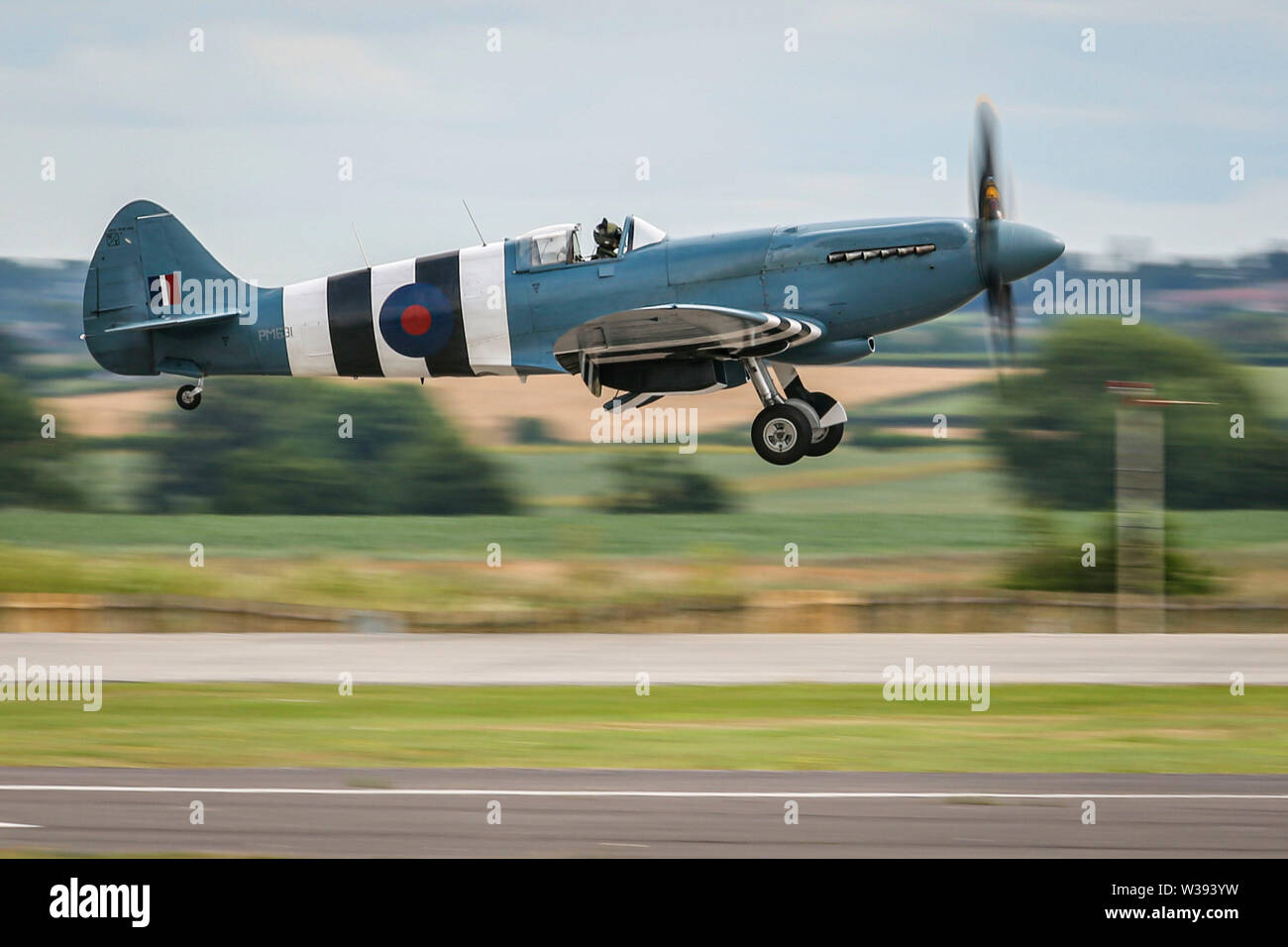 Yeovilton, UK. 13th July, 2019. A Spitfire of the Battle of Britain Memorial Flight, landing at the airshow in Yeovilton. Credit: Matthew Lofthouse/Alamy Live News Stock Photo