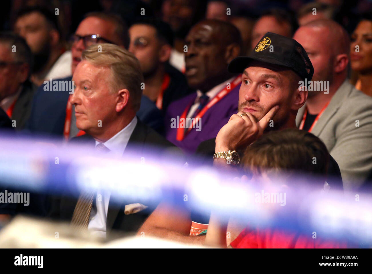 Tyson Fury watches match action with promoter Frank Warren at the O2 Arena, London. - Stock Image